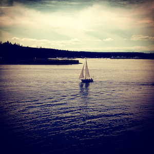 photo of a sailboat on puget sound